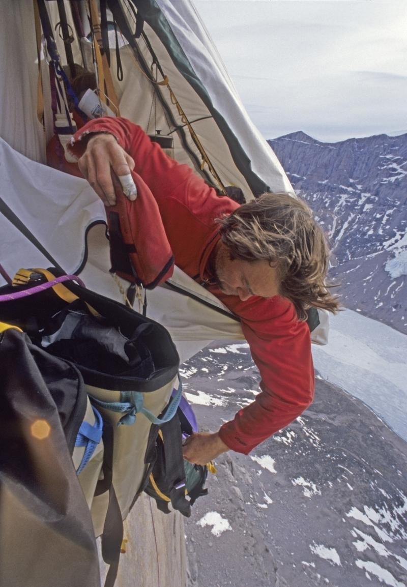 Image: 0094749266, License: Rights managed, PIC BY GORDON WILTSIE / NATIONAL GEOGRAPHIC STOCK / CATERS NEWS - (PICTURED:Alex Lowe in portaledge camp high on overhanging granite wall on Great Sail Peak, Baffin Island, Nunavut, Canada) - Hanging precariously in TENTS off a jaw-dropping 4,000ft vertical cliff face wouldnt be most peoples idea of the perfect camping trip.But for these daredevil explorers, scaling cliffs and pitching tents at the equivalent height of more than 300 double decker buses is just a normal day at the office.For them, chasing the longest and hardest - and probably most dangerous - big wall climb ever attempted is a challenge they chase every day. And as these stunning pictures show, because the climbs can last for weeks they must set up tents on the edge of monster-sized cliff faces for much needed rest. The incredible pictures were taken by adventure photographer Gordon Wiltsie, 57, who risks his own life to capture these unbelievable thrill-seeking moments. He said: During this climb it was the Arctic spring so melting snow on both the summit and a ledge midway up the cliff constantly sent rocks and chunks of ice flying down.SEE CATERS COPY, Model Release: No or not aplicable, Credit line: Profimedia.cz, Caters News