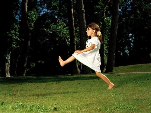 Girl Playing in Park --- Image by © Darius Ramazani/Corbis